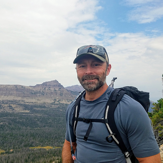 Clearwater Executive Team Member Clinton Summers hiking outdoors