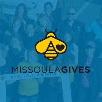 Photo of crowd during Missoula Gives in the background with the Missoula Gives bee logo over top of the image.
